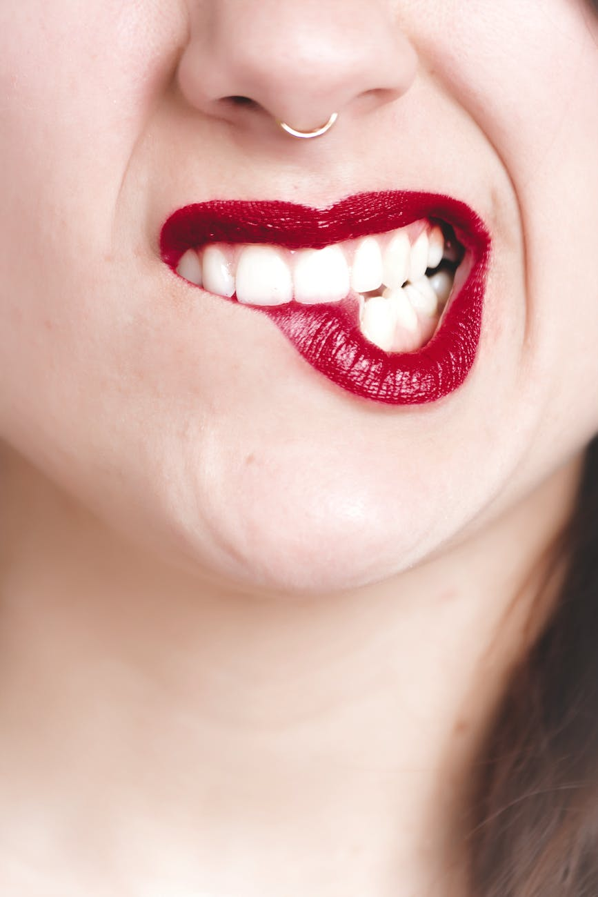 photography of woman s red lip
