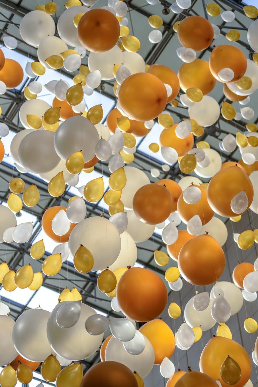 yellow balloon beside white balloon