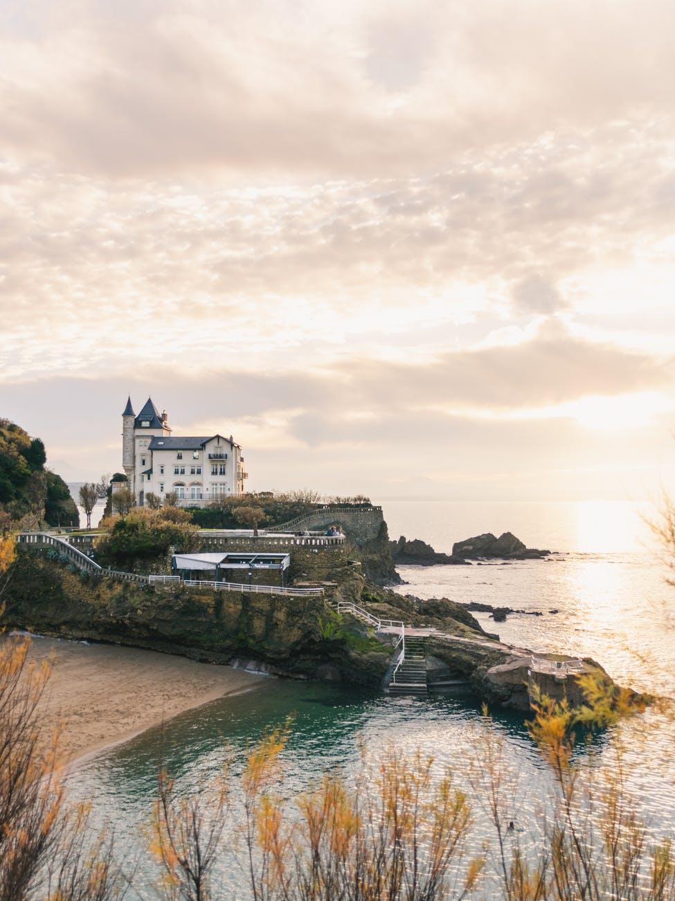 old castle on rocky coast near sea