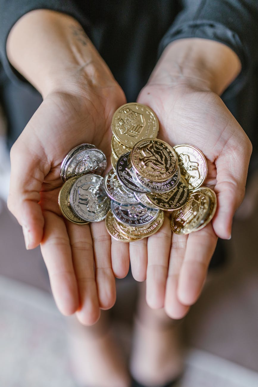 anonymous person holding coins